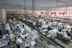 Textile factory production machinist working in line Stock Image