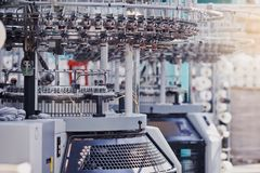 Textile factory in spinning production line and a rotating machinery and equipment production company. Modern Textile Factory. Rows of automated machines for stock images