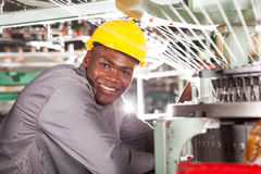 Textile factory worker. Happy african american textile factory worker Royalty Free Stock Images