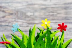 Springtime conceptual image. Textile flowers decor infront of wooden background with copy space Royalty Free Stock Photos