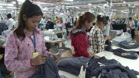 Textile Garment Factory: Female workers sort completed garments