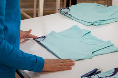 Textile and garment factory. At a garment factory quality control check for defects stock photos