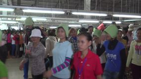Textile Garment Factory Workers: WS crowd of workers leaving for lunch #1 stock video footage
