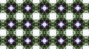 Textile geometric pattern. Green and purple. Rhombuses and squares. Stock Image