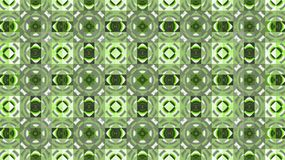Textile geometric pattern. Green and white. Rhombuses. circles and squares. Stock Photo