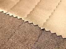 Textile golden texture sample Stock Photography