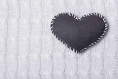 Textile  heart on a knitted texture Stock Images