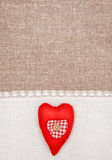 Textile heart and linen cloth on the burlap Stock Photo
