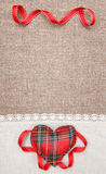 Textile heart and linen cloth on the burlap Stock Images