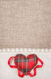 Textile heart and linen cloth on the burlap Stock Photography