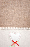 Textile heart and linen cloth on the burlap Stock Image