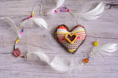 Free Textile Heart Of Handmade With Ethnic Ornament On A Grayish Old Aged Background. Decorative Element Of White Feathers. Ceramic Hea Royalty Free Stock Photo - 109111105