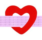 Textile heart over electrocardiogram graph on white Stock Images