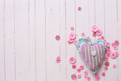 Textile heart and pink buttons Stock Photography