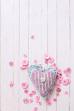 Textile heart and pink buttons Royalty Free Stock Photo