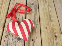 Textile heart with red ribbon Stock Photo
