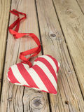 Textile heart with red ribbon Royalty Free Stock Photography