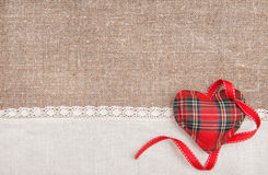 Textile heart, ribbon and linen cloth on the burlap Royalty Free Stock Images