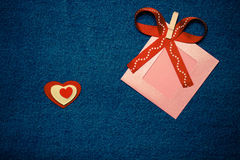 Textile heart, ribbon and pink photo frame. Romantic love theme Royalty Free Stock Image