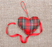 Textile heart and ribbon on sacking Stock Photography