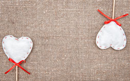 Textile hearts on the burlap. Background royalty free stock images