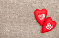 Textile hearts on the burlap. Background royalty free stock photo