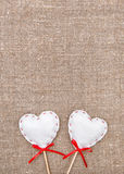 Textile hearts on the burlap. Background royalty free stock image