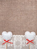 Textile hearts and lacy cloth on the burlap Royalty Free Stock Images