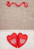 Textile hearts and linen cloth on the burlap Royalty Free Stock Photo