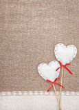Textile hearts and linen cloth on the burlap Stock Image