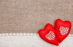 Textile hearts and linen cloth on the burlap Royalty Free Stock Photography