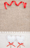 Textile hearts, ribbon and linen cloth on the burlap Royalty Free Stock Image