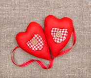 Textile hearts and ribbon on sacking Royalty Free Stock Photos