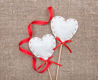 Textile hearts and ribbon on sacking Royalty Free Stock Images