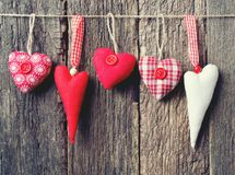 Textile hearts on rustic. Wooden surface Stock Photography