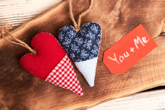 Textile hearts on wooden surface. Royalty Free Stock Images
