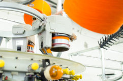 Textile: Industrial Embroidery Machine. Machinery and equipment in a spinning production company. Machinery and equipment in a spinning production company Royalty Free Stock Image