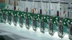 Textile industry with knitting machines in factory.  stock footage