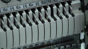 Textile industry with knitting machines in factory.  stock video footage