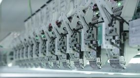 Textile industry with knitting machines in factory stock video footage