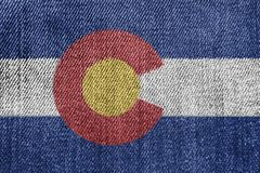 Textile Industry Or Politics Concept: Colorado Flag Denim Jeans. Background Texture royalty free stock images
