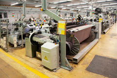 Textile industry - Weaving and warping Stock Image