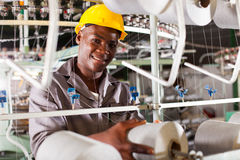 Textile industry worker. Young african textile industry worker in factory Royalty Free Stock Photography