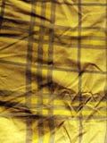 Textile jaune écossais Images stock
