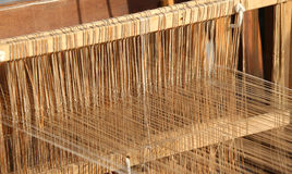 Textile loom for weaving of yarns of cotton and wool. Ancient textile loom for weaving of yarns of cotton and wool Stock Images