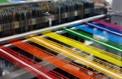 Textile machine. With rainbow colors threads royalty free stock photo