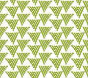 Textile pattern from green triangular graduations Stock Photos