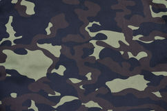 Textile pattern of military camouflage fabric. Texture of fabric with a camouflage painted in colors of the marsh. Army background image. Textile pattern of royalty free stock image