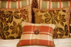 Textile Patterned Cushions. A home & garden close up shot featuring Textile Patterned Cushions Royalty Free Stock Image