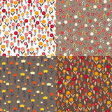 Textile patterns of flowers. Set textile patterns of flowers. It includes various stylized flowers, tulips, daisies, buttercups. all in warm natural colors Stock Photography